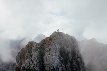 Man under clouds