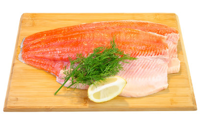 Trout fish fillet on a kitchen board