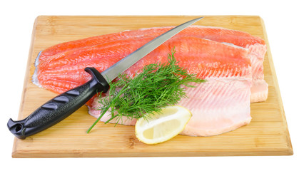 Trout fish fillet with knife on a kitchen board