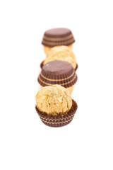 Three in row chocolate bonbons.
