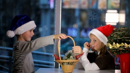 Girl and boy cafes consider Christmas decorations