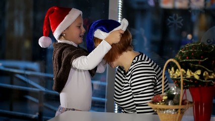 woman and little girl cap of Santa Claus dress
