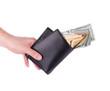Purse in hand full with dollar bills.