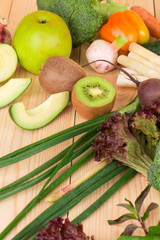 Vegetables on a wooden table in the closeup.