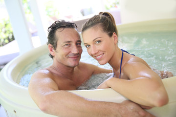 Romantic couple relaxing in hot tub