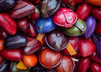 Christmas market. Colorful small leather goods.