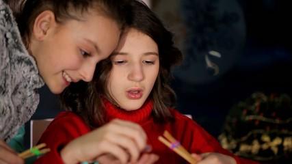 Girl girlfriend teaches creative weaving of threads