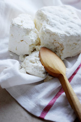 cottage cheese with a wooden spoon