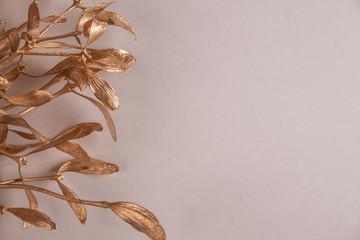gold mistletoe on gray background