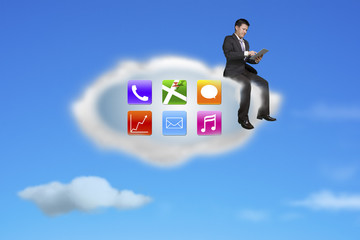 businessman using tablet on app icons cloud with nature sky