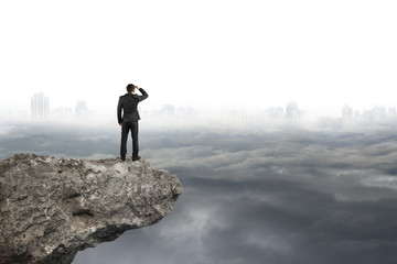 man looking on cliff with gray cloudy sky cityscape  background