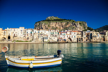 boat drifting in a harbor of Cefalu