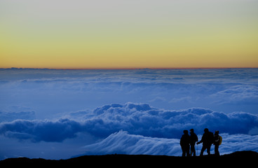 Group of climbers above the clouds.