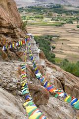 Buddhist prayer flags near Buddhist monastery in Ladakh, India