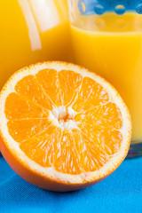 close view on fresh orange juice and fruit