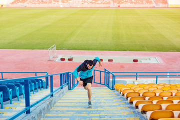 sportsman doing speed exercise for muscles on stairs on stadium