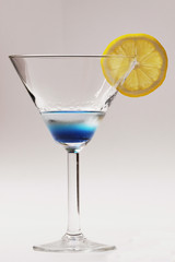blue cocktail with yellow lemon
