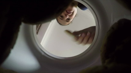 POV shot of friends taking cookies from a jar