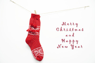 Red wool Christmas socks hanging on white wall