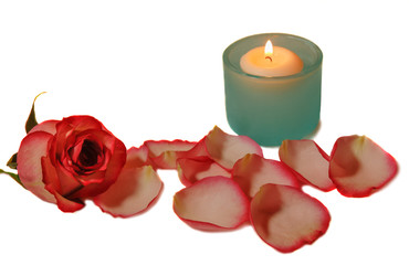 Blue glass candlestick, rose  and rose petals