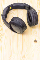 Wireless headphones, on a wooden table