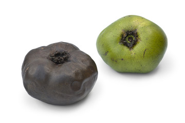 Ripe and unripe black sapote fruit