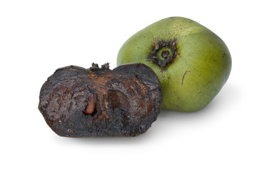 Whole and partial black sapote fruit