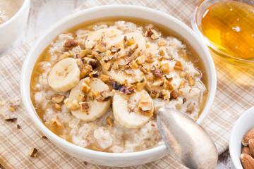 healthy breakfast - oatmeal with banana, honey and walnuts