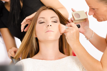 Make up artist and hairdresser at work