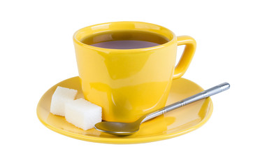 Tea with sugar in yellow cup
