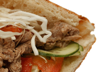 Donner kebab sandwich with beef meat closeup. Isolated on white