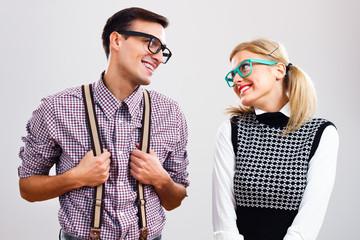 Shy nerdy woman and man are flirting