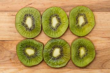 fresh kiwi slices on cutting board
