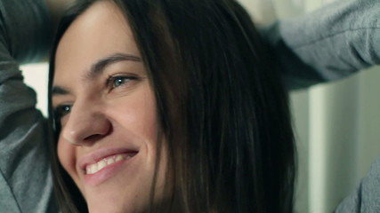 Happy smiling beautiful woman standing near window