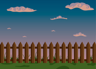 Wooden fence and green grass with sky