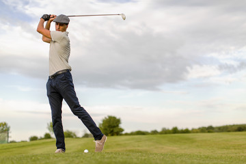 Young man playing golf