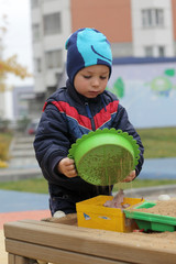 Child playing with sieve