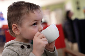 Kid drinks tea