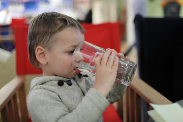 Kid drinks water