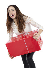 Excited shopper woman with a gift box