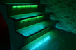 Leinwandbild Motiv Illuminated wooden stairs