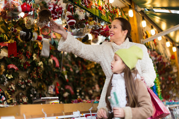 Mother with daughter in Christmas market