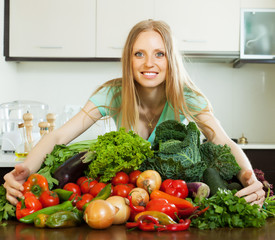 woman with pile of vegetables
