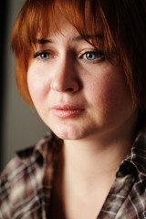 close-up portrait of confused woman
