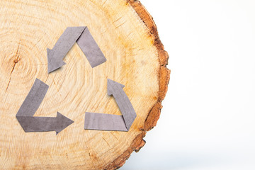 Close-up wooden cut and recycle symbol