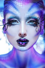 Vertical photo of fashionable model with creative make up