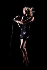Beautiful Woman with Microphone. Glamour Model Singer. Karaoke