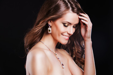 portrait of a beautiful brunette model with luxury accessories.