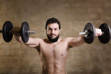 Hipster lifting weights