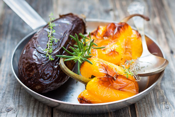 baked eggplant and yellow sweet peppers in a pan